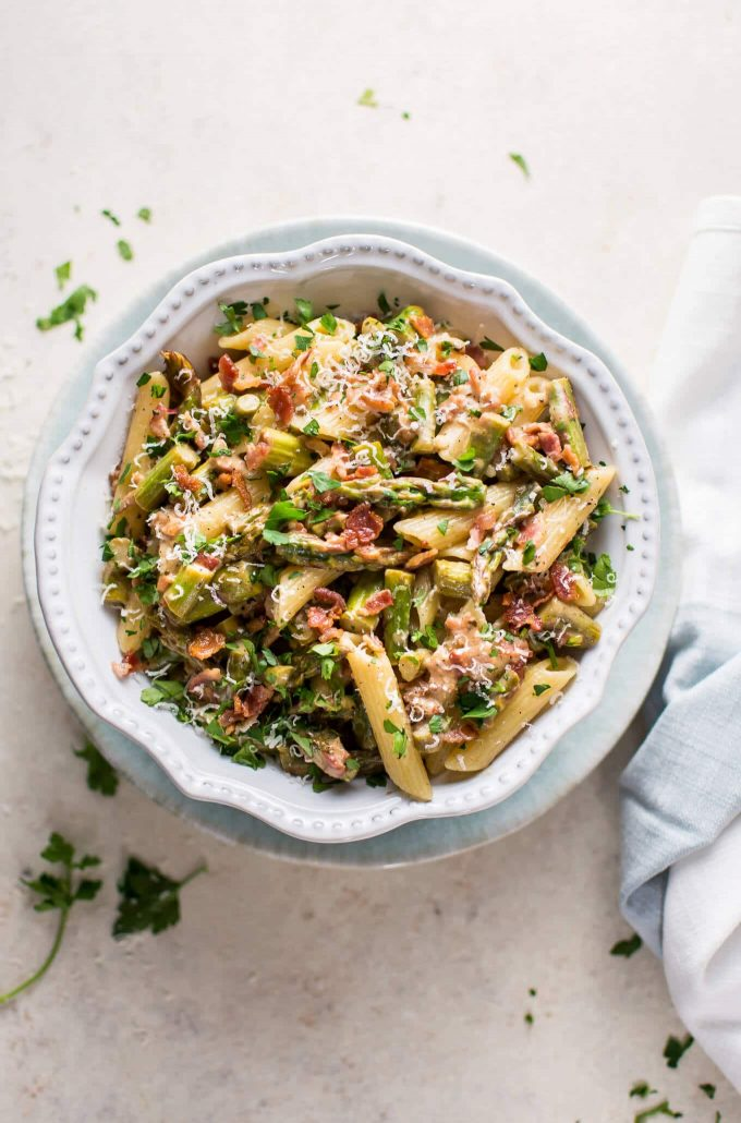 This asparagus and bacon pasta is fresh, lemony, a little bit creamy, and not too naughty! Perfect for spring.