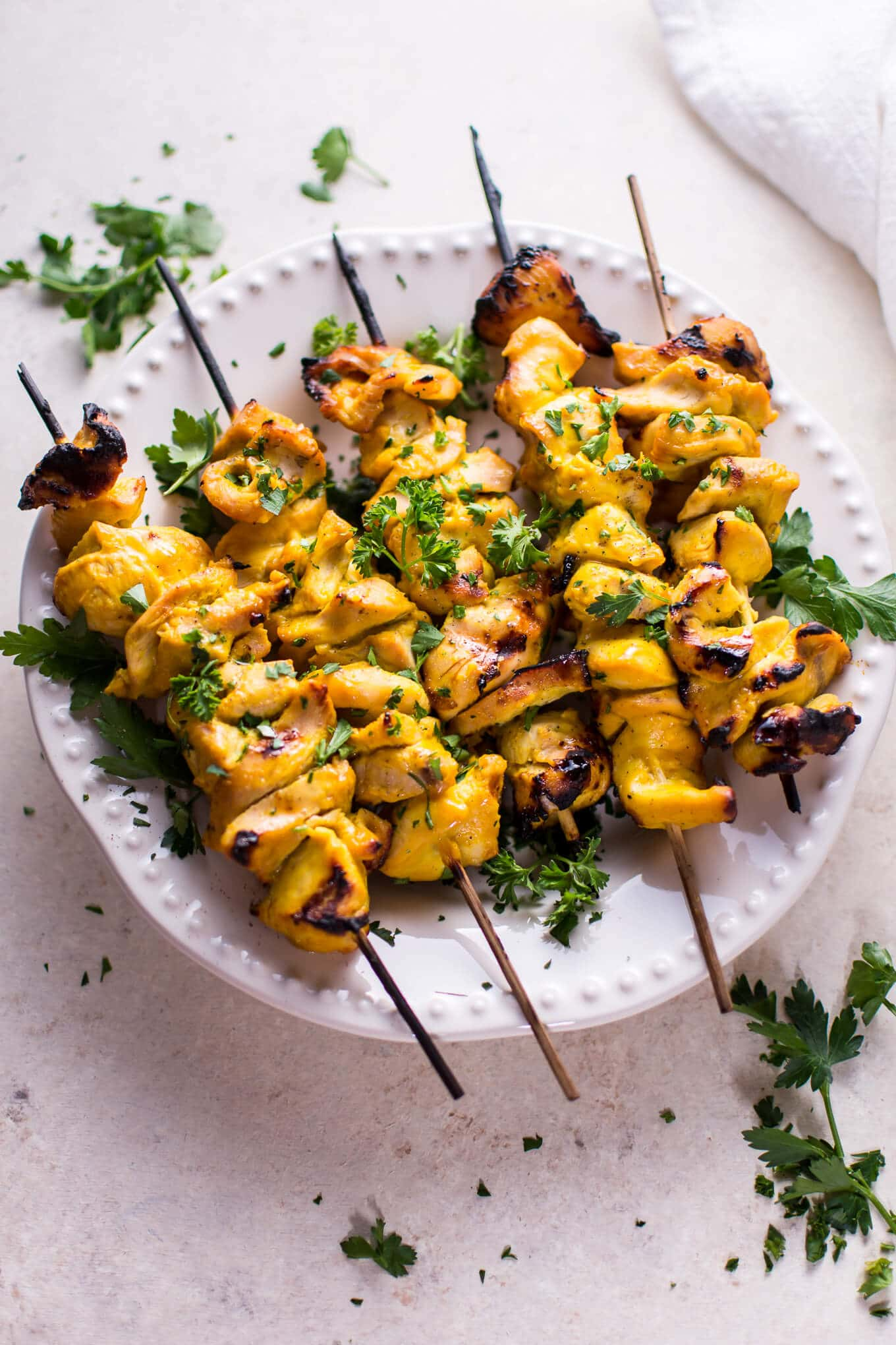 These grilled honey mustard chicken skewers are sure to become a family BBQ favorite this summer! The 3-ingredient marinade is super easy and tastes amazing.