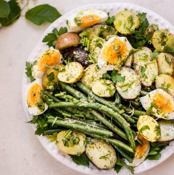 This potato and green bean salad with eggs is a light, fresh and healthy vegetarian summer side dish that you'll want to make all summer long! The lemon-herb vinaigrette makes it a great option for those who don't like mayo in their potato salad.