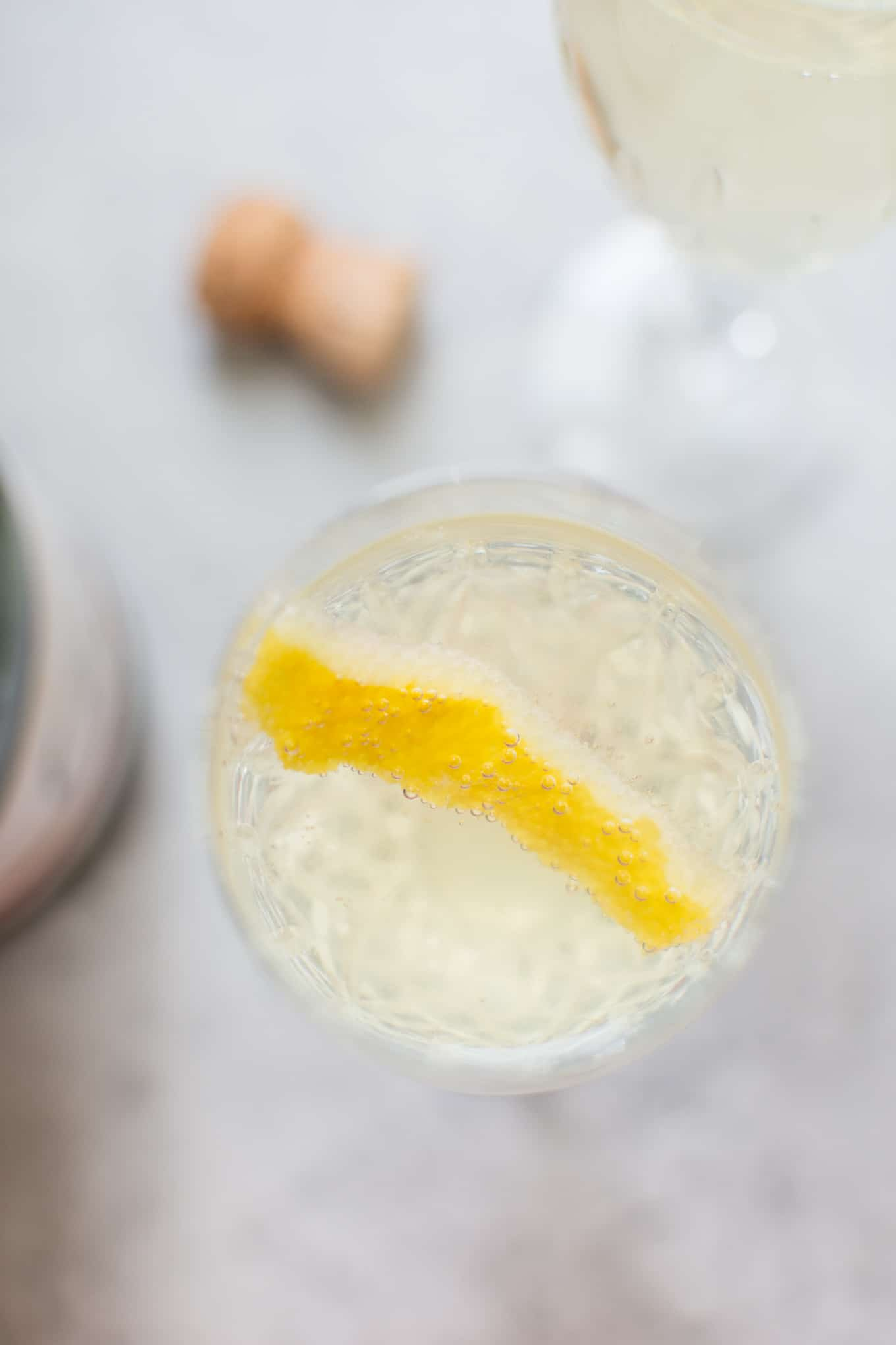 This lemon champagne cocktail is lively, refreshing, and perfect for summer. Lemon simple syrup adds just the right amount of sweetness and lemon flavor to this bubbly drink.