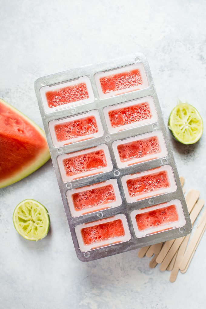 watermelon margarita popsicles in a tray
