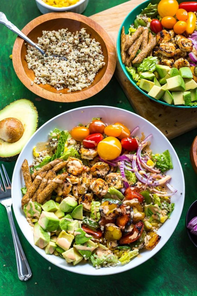 fiesta grilled shrimp salad with avocado and tomatoes in a bowl