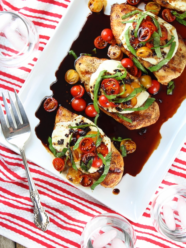 balsamic grilled chicken caprese on a plate with a fork
