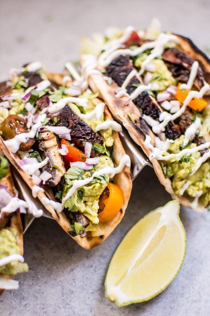close-up of portobello mushroom tacos with lime wedge