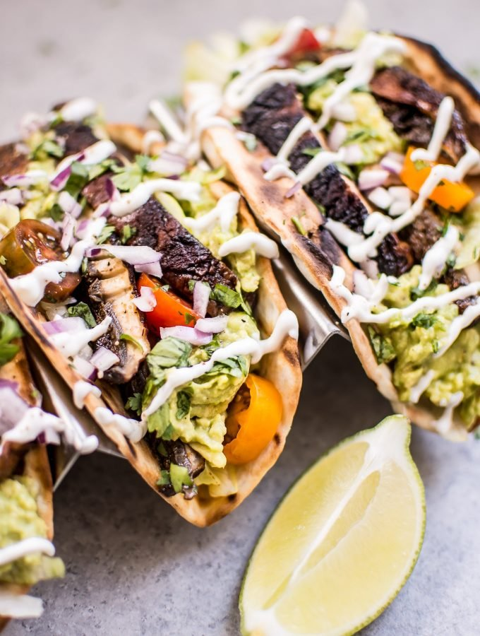 These vegetarian grilled portobello mushroom tacos are satisfying, healthy, TASTY, and make the perfect summer meal.