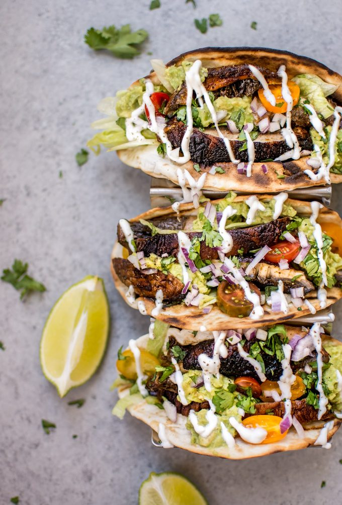 three healthy mushroom tacos and lime wedges