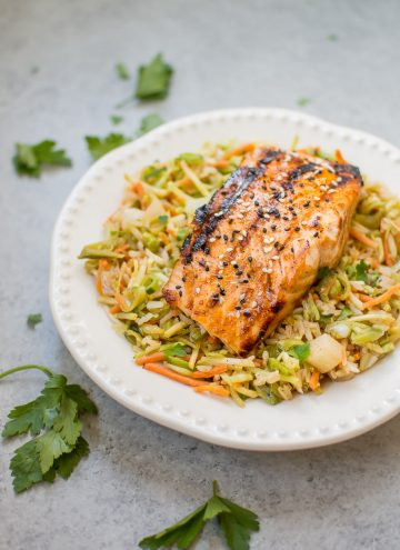 This sesame sriracha grilled salmon nourish bowl is a tasty, healthy, and convenient meal! Grilled honey garlic salmon is the perfect addition to this flavorful veggie and brown rice medley. #ad