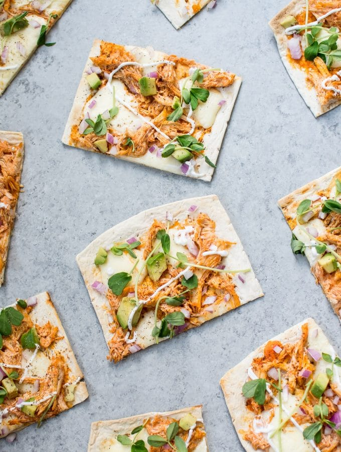 This skinny buffalo chicken flatbread pizza is a lighter way to enjoy the flavor of buffalo chicken wings. If you like it spicy, you'll love this healthy flatbread recipe!