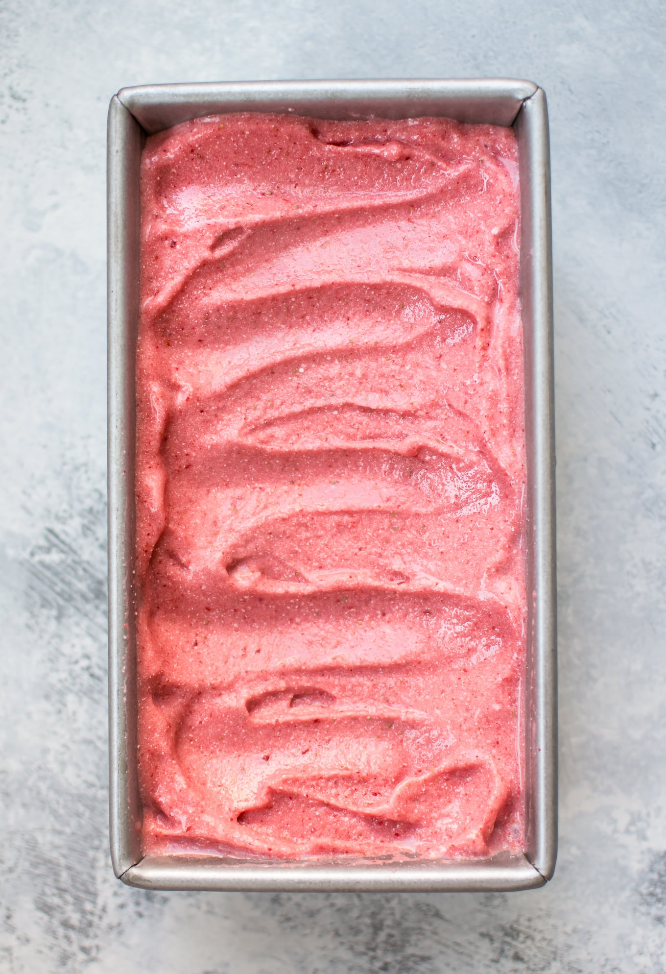 This 2-ingredient vegan strawberry ice cream is made with frozen strawberries, coconut milk, and your food processor in less than 10 minutes!