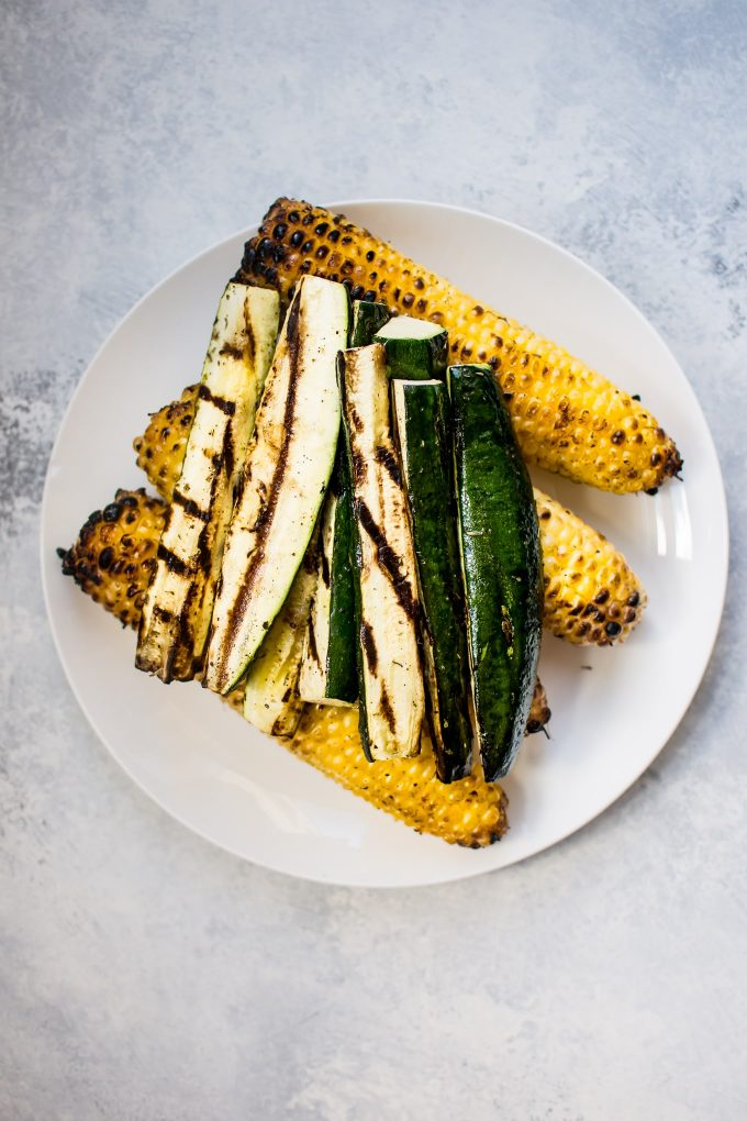 grilled corn and zucchini on a plate