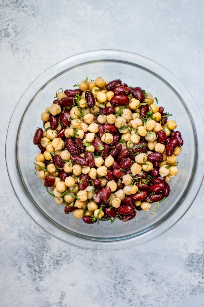 This kidney bean and chickpea salad is ridiculously easy with only 5 ingredients! Healthy, delicious, and ready in under 10 minutes.