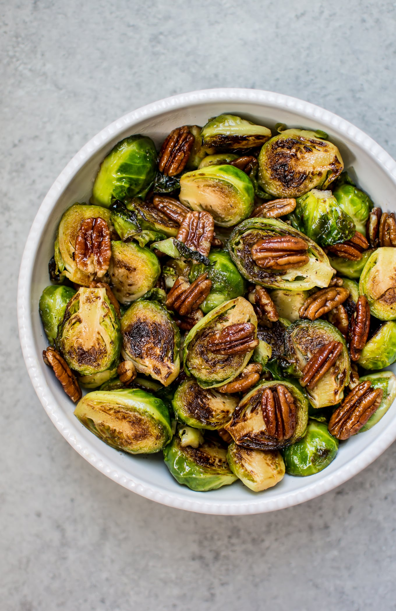 These maple pecan Brussels sprouts are the perfect savory-sweet side dish. Easy to make and ready in less than 20 minutes!
