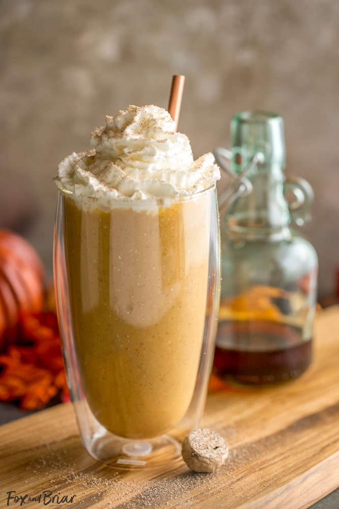 healthy pumpkin pie smoothie in a glass with a straw