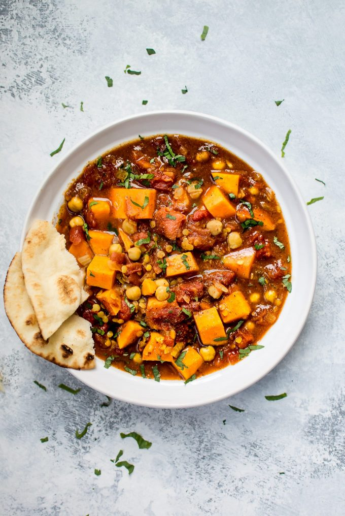 This sweet potato curry is made easy in the Crockpot! You will love this easy vegan slow cooker recipe. It's full of healthy ingredients including chickpeas and red lentils.