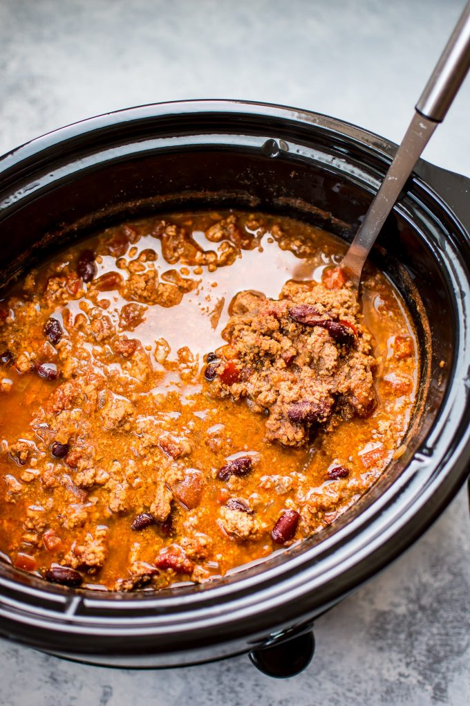 turkey chili in a slow cooker with ladle