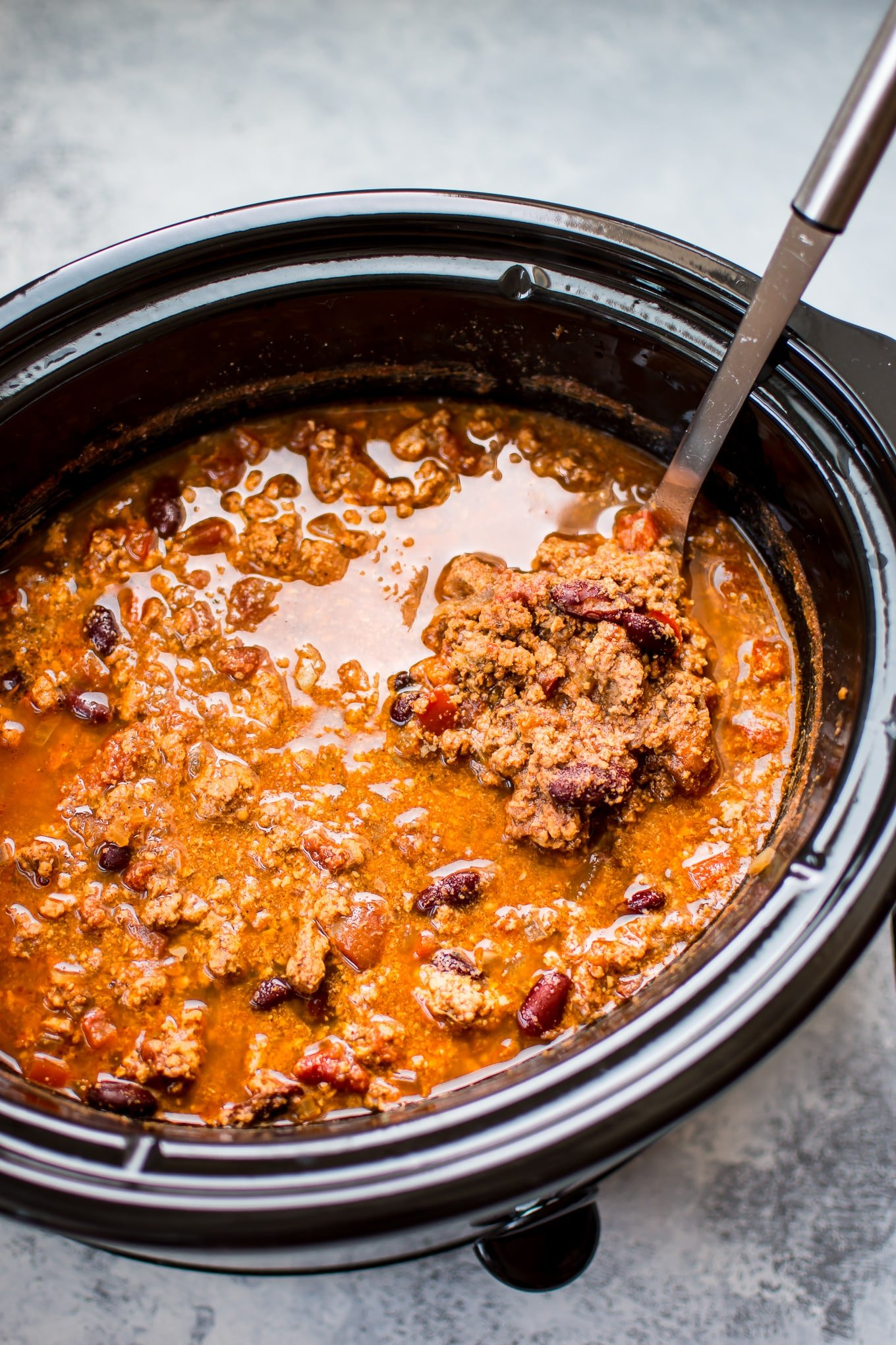 This easy crockpot turkey chili recipe is healthy, hearty, and comforting. A big batch will give you tons of tasty leftovers!
