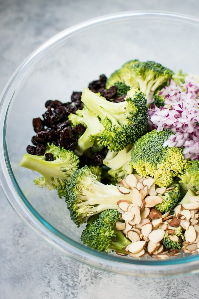 This healthy broccoli salad is a lightened-up version of your favorite! It's crunchy, tangy, sweet, and makes the perfect side dish.