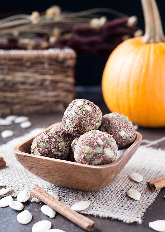 several chai pumpkin bliss balls in a wooden bowl