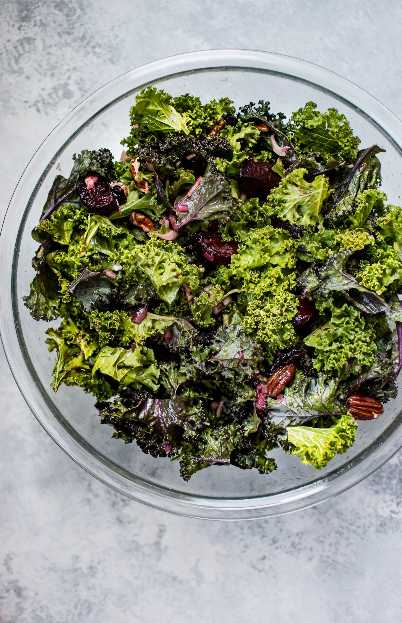This kale and beet salad is a healthy vegetarian fall salad with dried cranberries, pecans, and a tangy balsamic vinaigrette dressing.