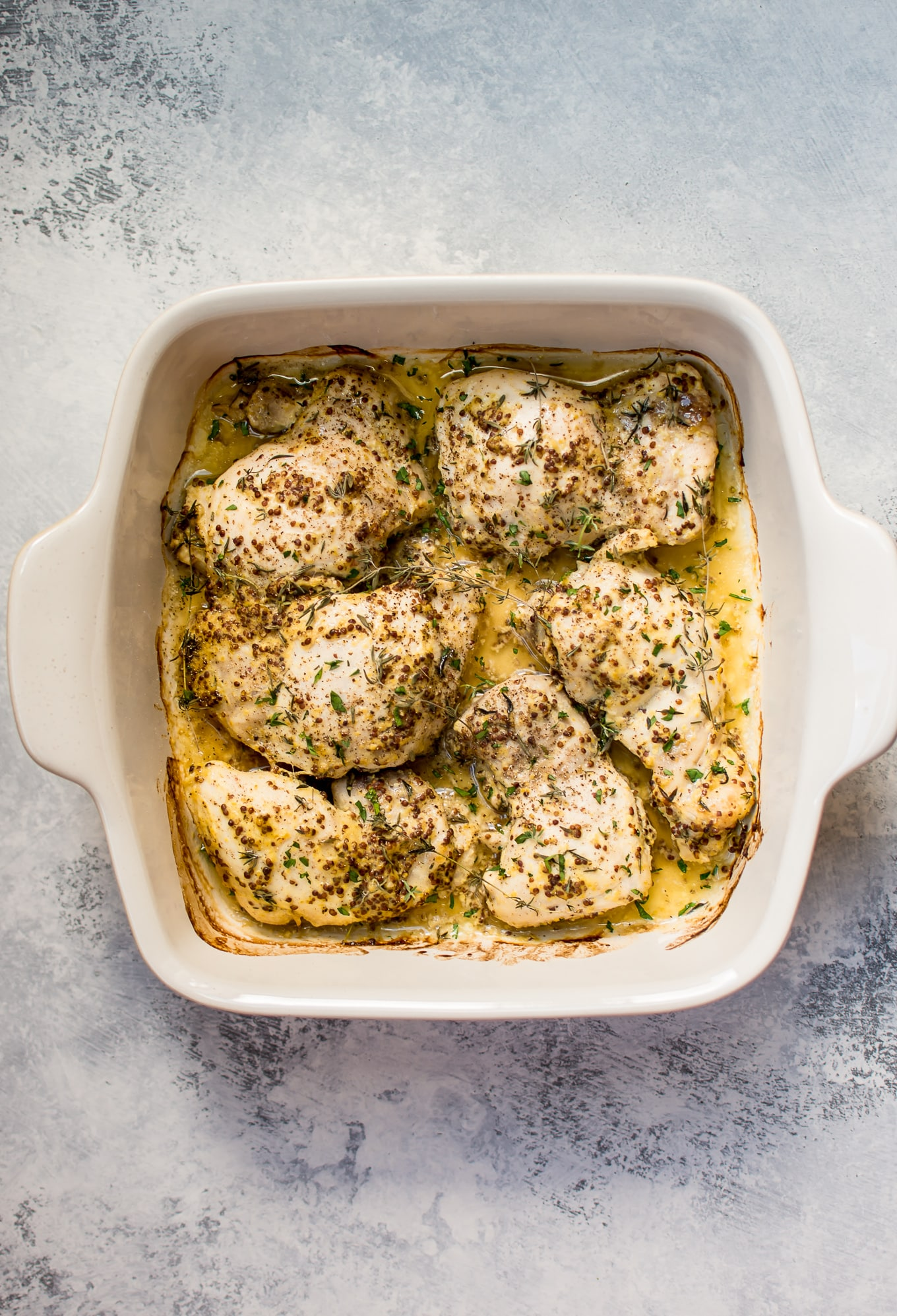 These easy roasted mustard chicken thighs have only a handful of ingredients and come together fast with minimal effort. They stay succulent and juicy, and you will love the light pan sauce.