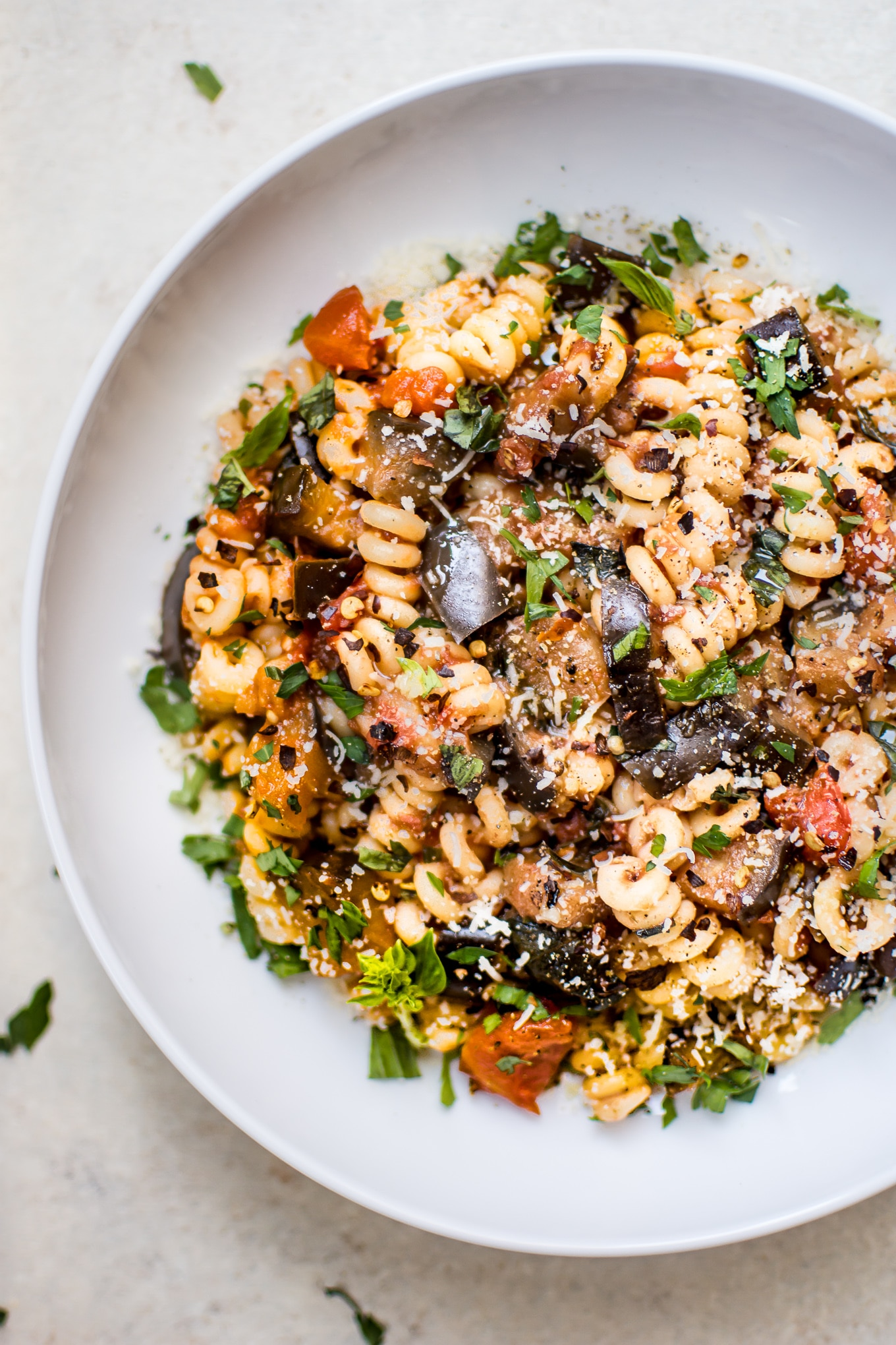 This spicy eggplant pasta recipe is a simple, healthy, and quick vegetarian pasta dish. It's ready in under half an hour - perfect for busy weeknights.