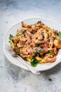 This spicy shrimp pasta with a roasted tomato sauce is easy, fast, and very flavorful. Perfect for a gourmet weeknight dinner or for entertaining.