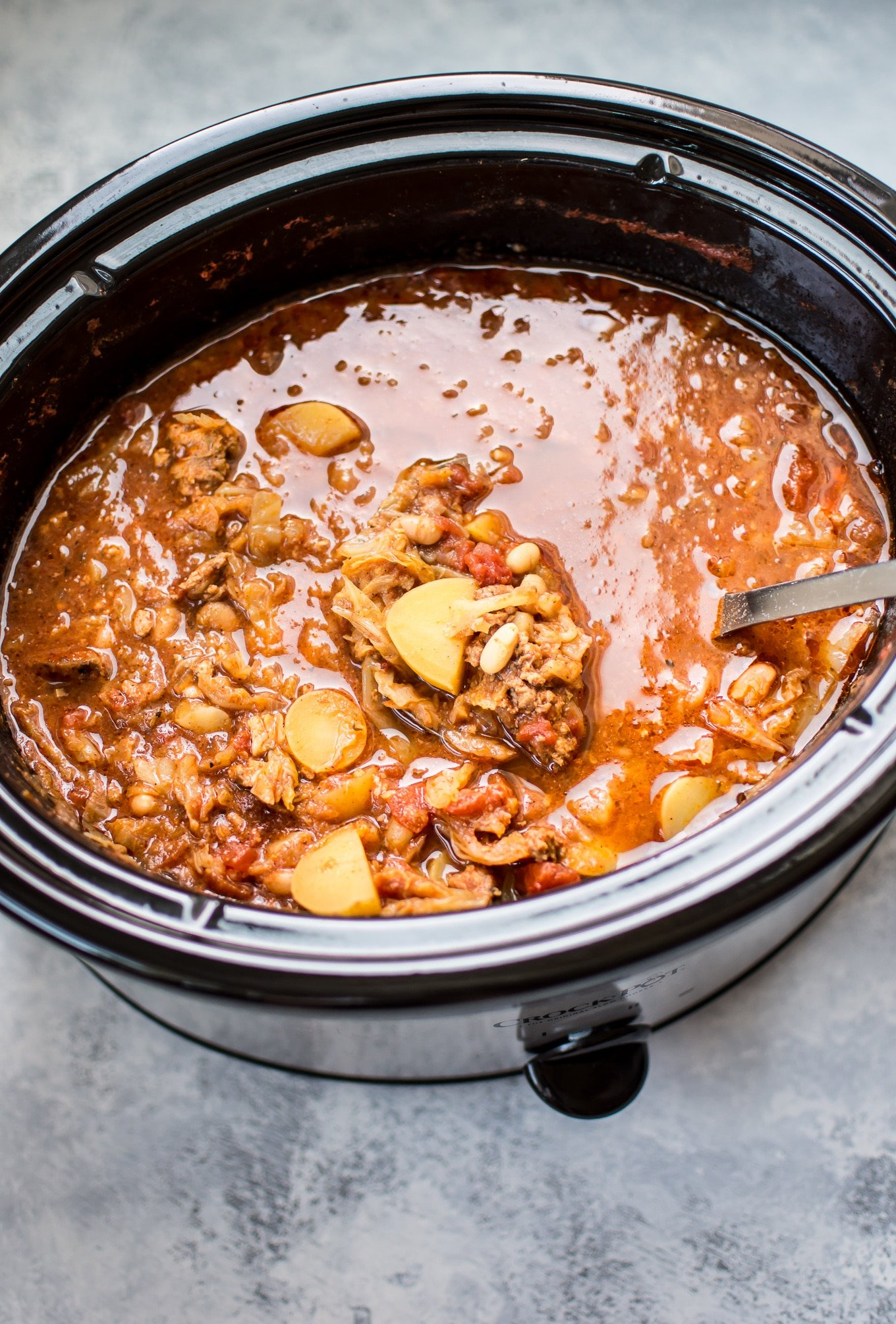 This Crockpot cabbage soup is hearty, warming, and packed with flavor! Throw everything in the slow cooker, and you'll come home to a delicious hot bowl of soup.