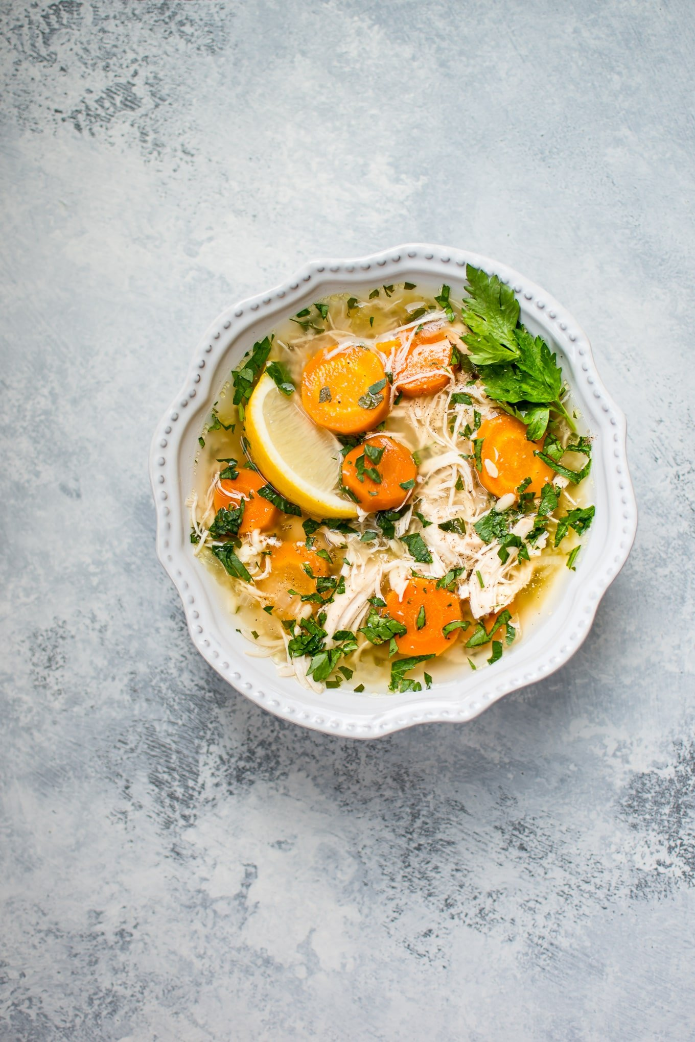 This Crockpot lemon chicken orzo soup recipe is healthy, super easy, andfamily-friendly. Come home to a steaming bowl of deliciousness!
