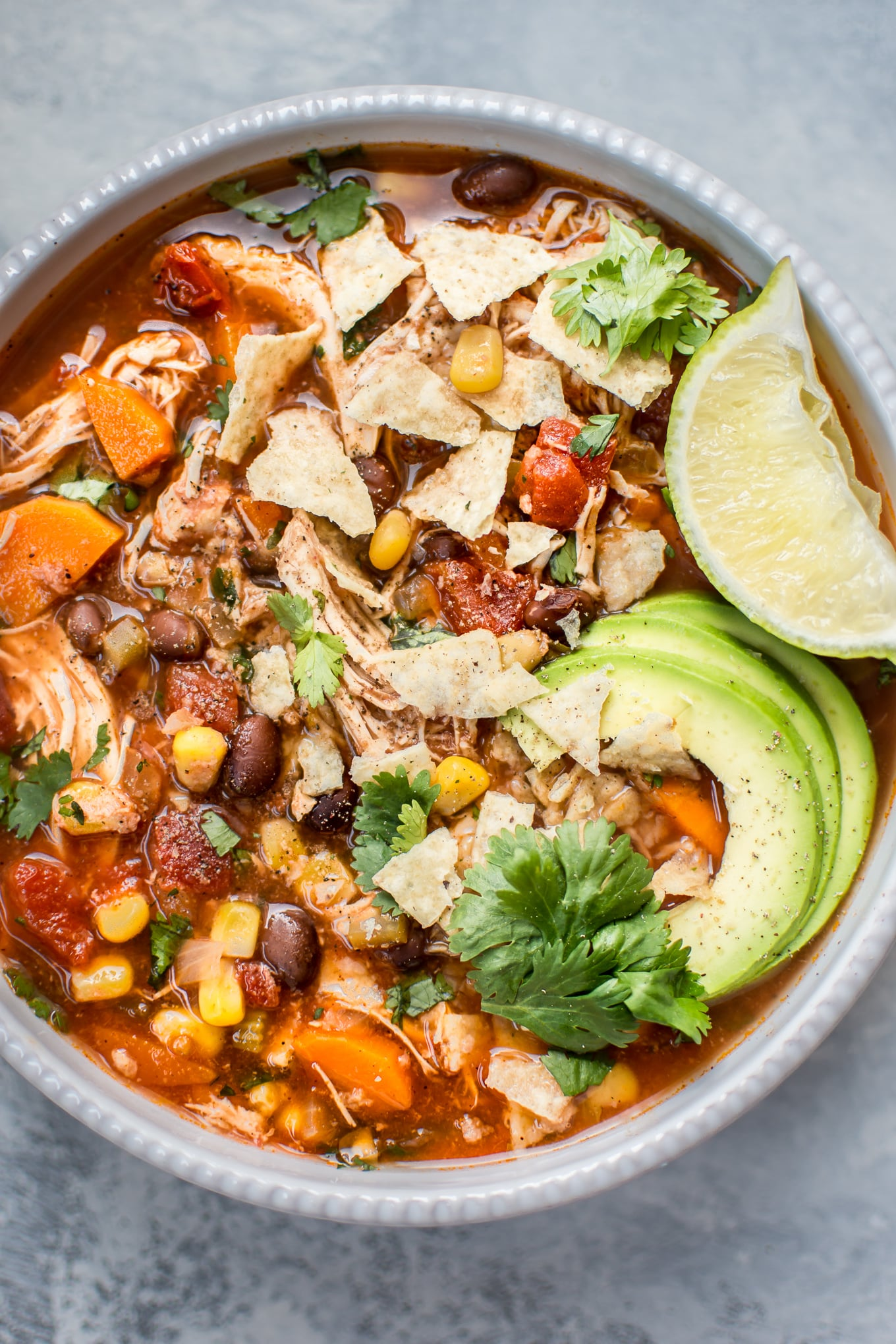 This Crockpot Mexican chicken soup is fresh, tangy, and comforting. Set it and forget it, and you'll come back home to a wonderful healthy homemade soup!