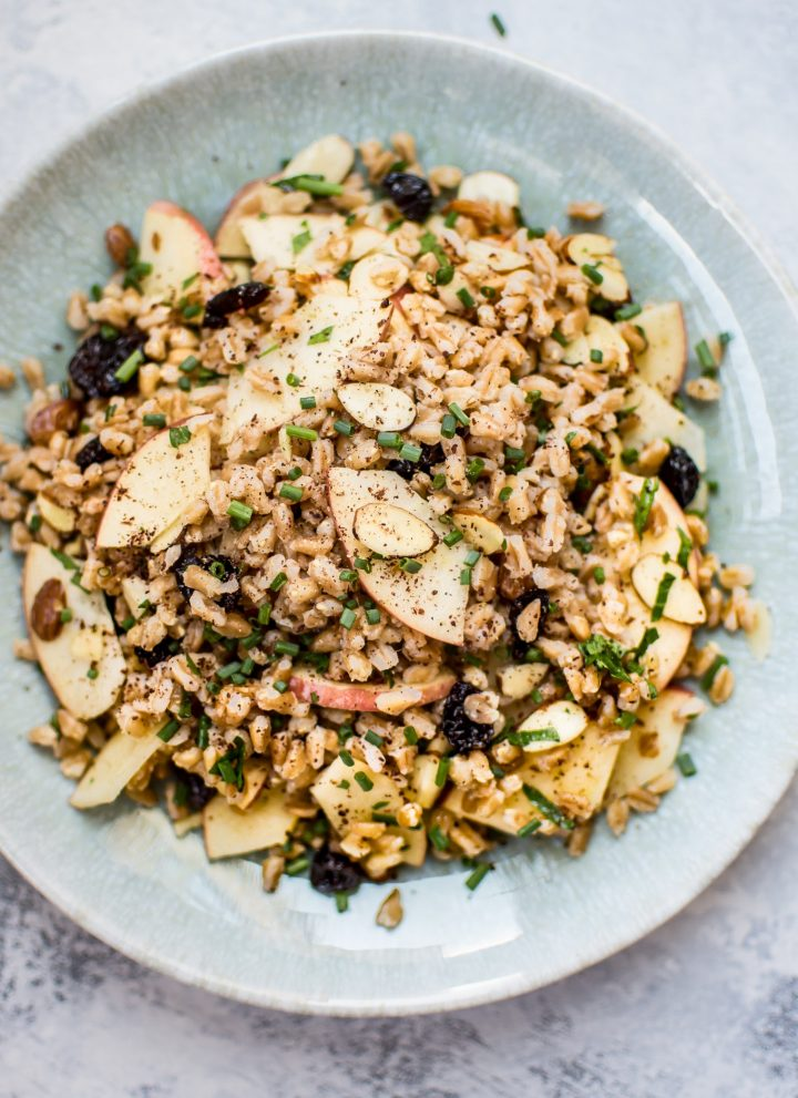 This healthy vegan farro salad is packed with dried cranberries, sliced almonds, honeycrisp apple slices, chives, and a lemon vinaigrette. It makes a wonderful light lunch or side dish.