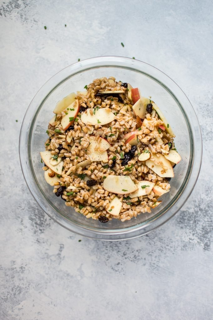 glass bowl with fall farro salad with apple slices