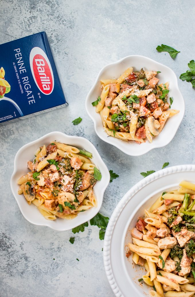 This lighter chicken and bacon pasta is made healthier with Canadian bacon, lean chicken breast, half-and-half, and fresh vegetables. Cajun spices and plenty of garlic take the flavor to the next level!