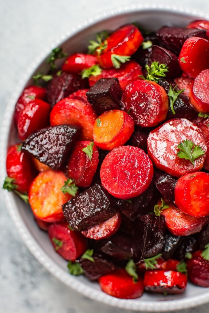 This maple roasted beets and carrots recipe is an easy, colorful, and healthy side dish. Perfect for your holiday table!