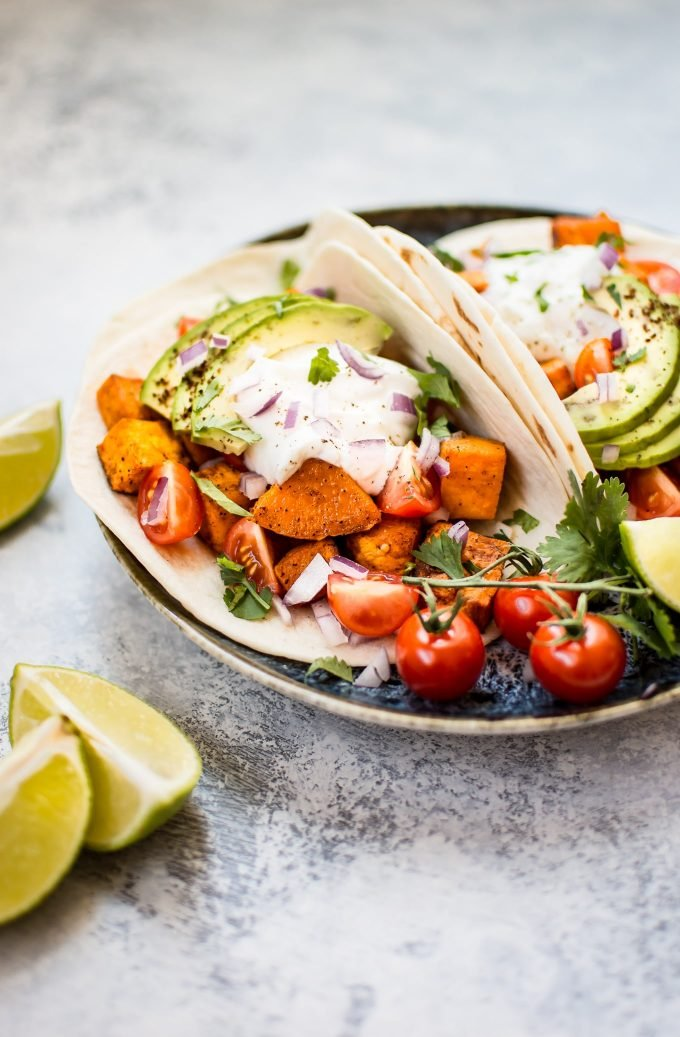 This roasted sweet potato tacos recipe makes a delicious, filling, and nutritious meat-free meal! Load 'em up with your favorite toppings and enjoy these all season long.