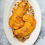 Honey cinnamon roasted hasselback butternut squash is a showstopping vegetarian side dish that would look perfect on your Thanksgiving table!