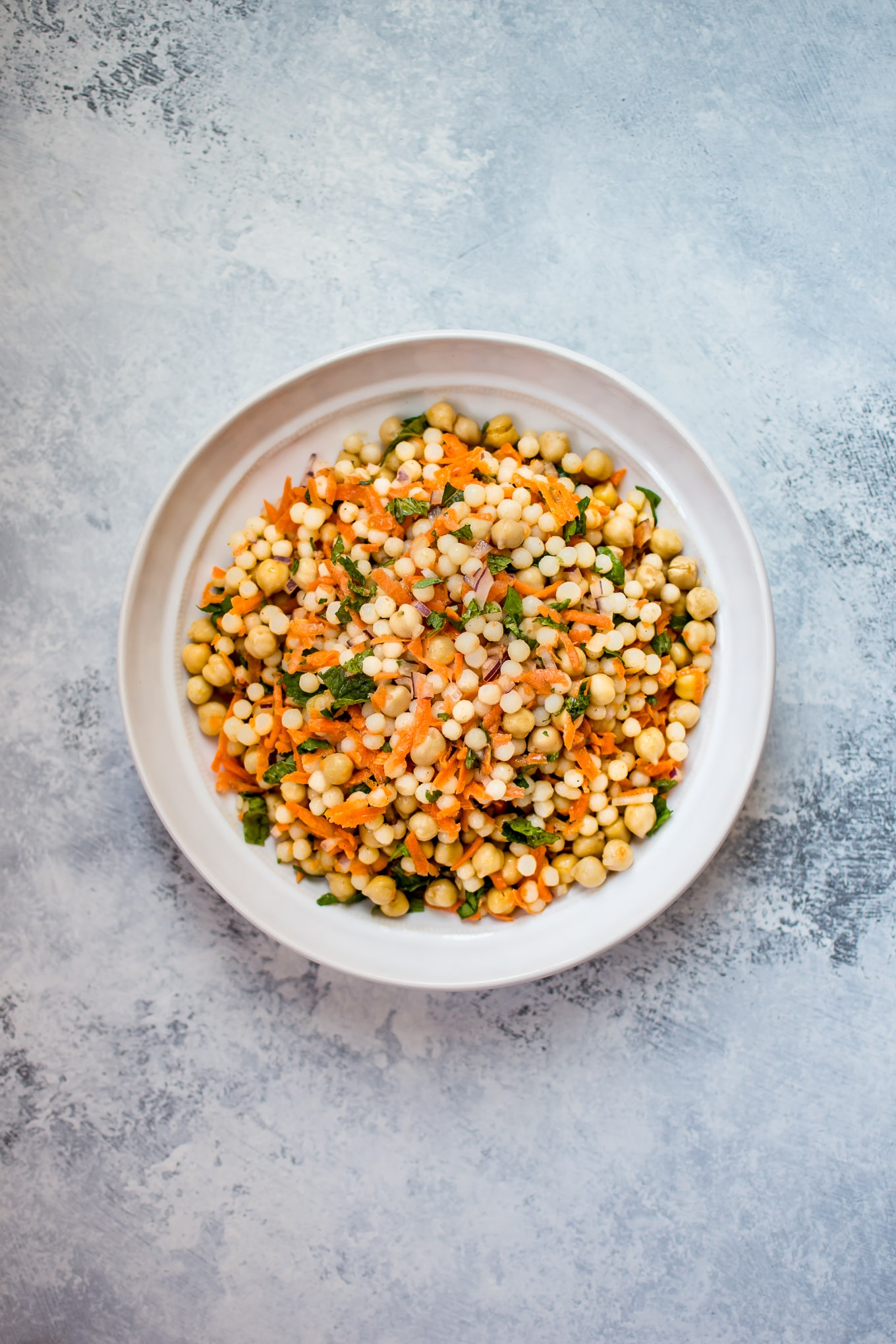This vegan Israeli couscous salad recipe makes a wonderfully fresh light lunch or side salad. It's satisfying, healthy, and filling.