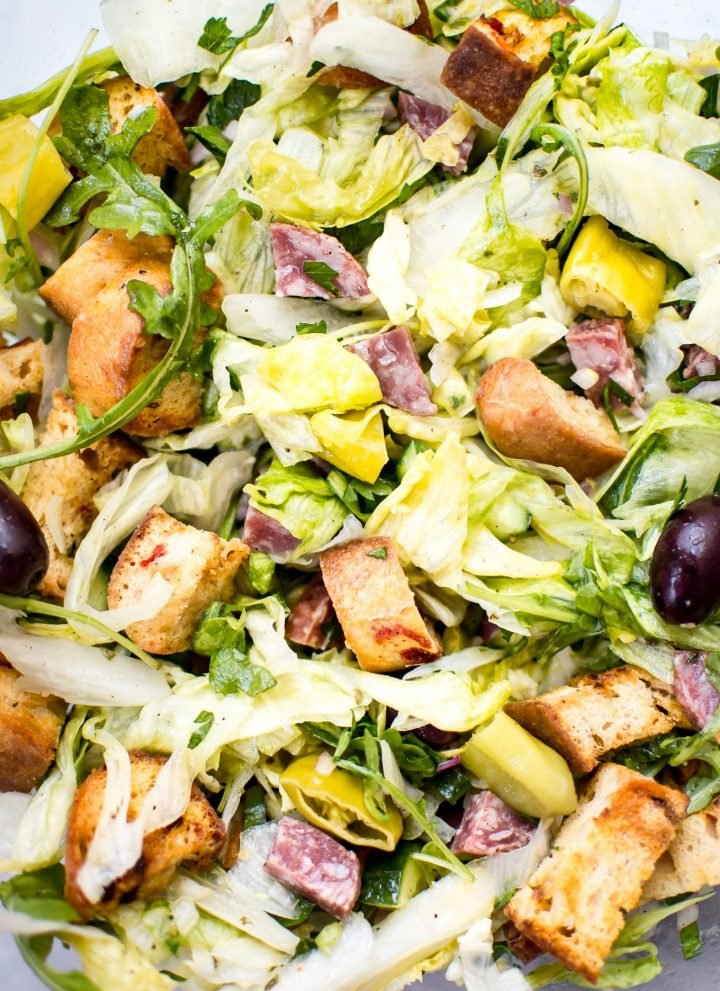 This Italian chopped salad recipe is easy, fast, and fresh. Salami, homemade croutons, and pepperoncini peppers make this one flavorful salad!