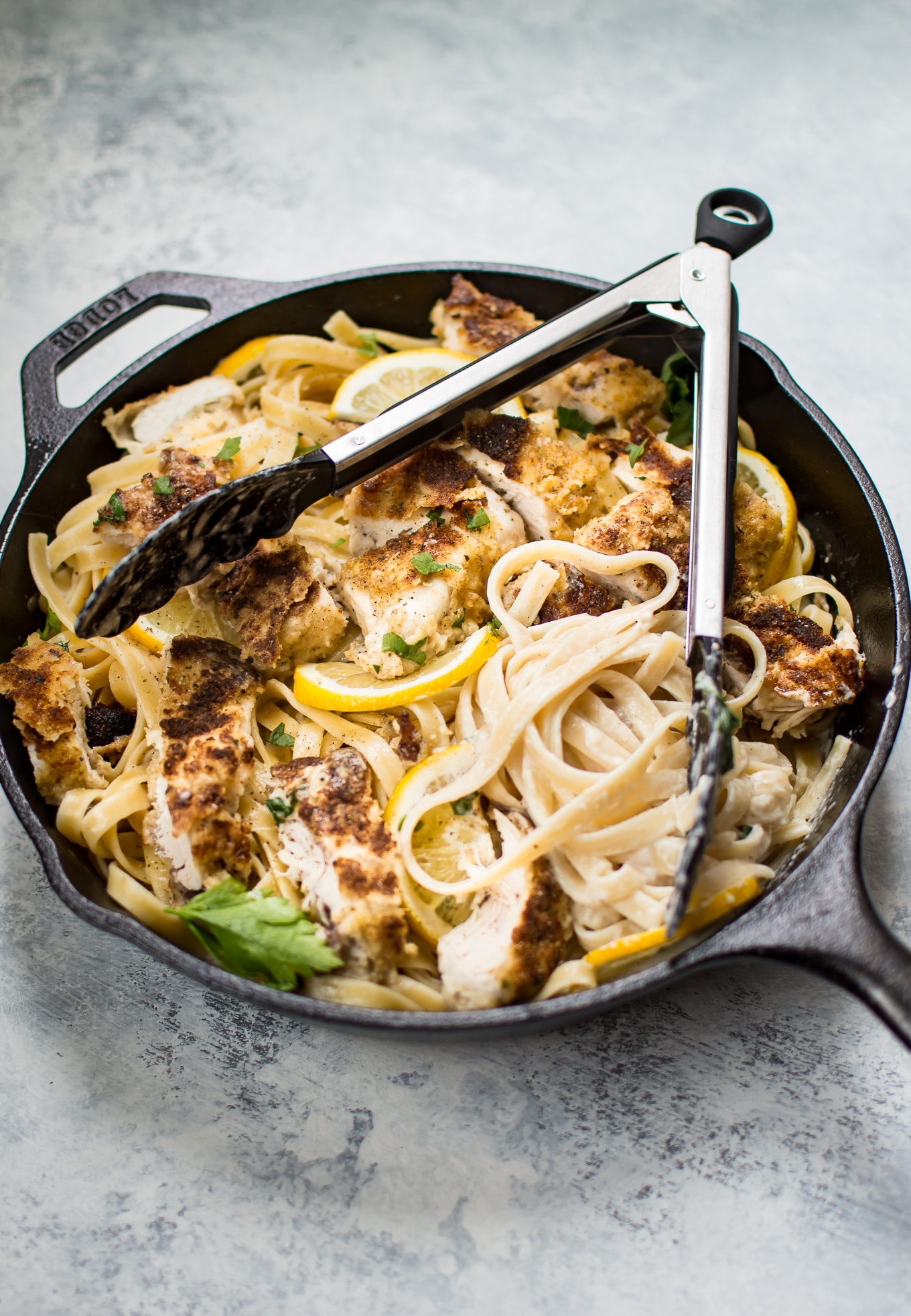 This lemon parmesan chicken Alfredo recipe is a delicious and decadent way to enjoy pasta! The sauce is irresistibly creamy with plenty of lemon and garlic! The tender breaded chicken adds another layer of comfort and flavor to this easy pasta dish.