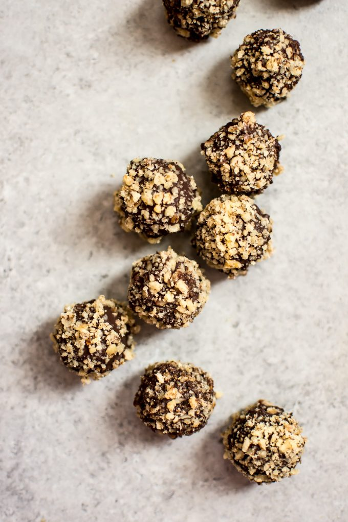 These easy rum truffles are vegan, gluten-free, and make a fun little no-bake treat that's perfect for the holidays.