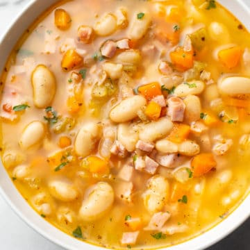 ham and bean soup (close-up in a white bowl)