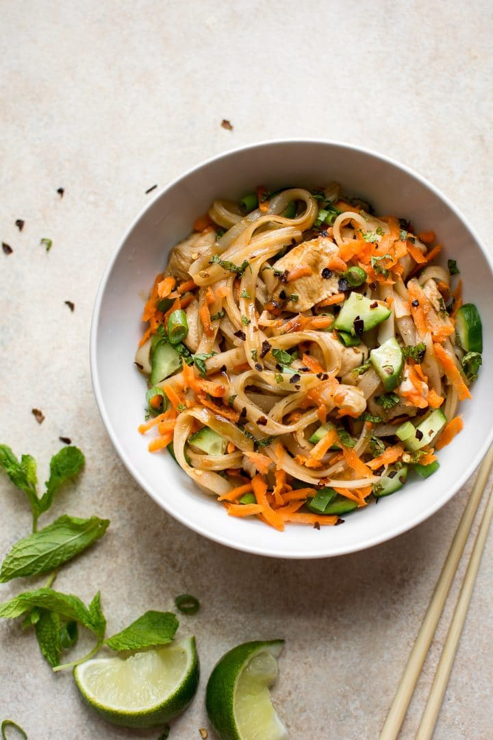 Delicious chicken rice noodle stir fry with a sweet and savory sauce. Lime, carrots, cucumber, and mint make this stir fry recipe extra fresh!