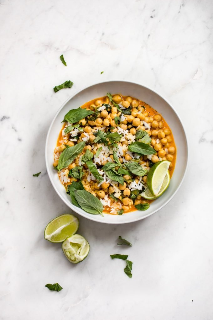 This quick and easy vegan chickpea coconut curry is ready in less than 15 minutes! It's fresh, healthy, and delicious. Great served over rice!