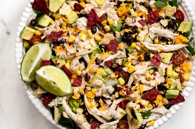 This healthy chicken taco salad recipe is fresh, filled with healthy goodies, and topped off with the most delicious chipotle ranch dressing.