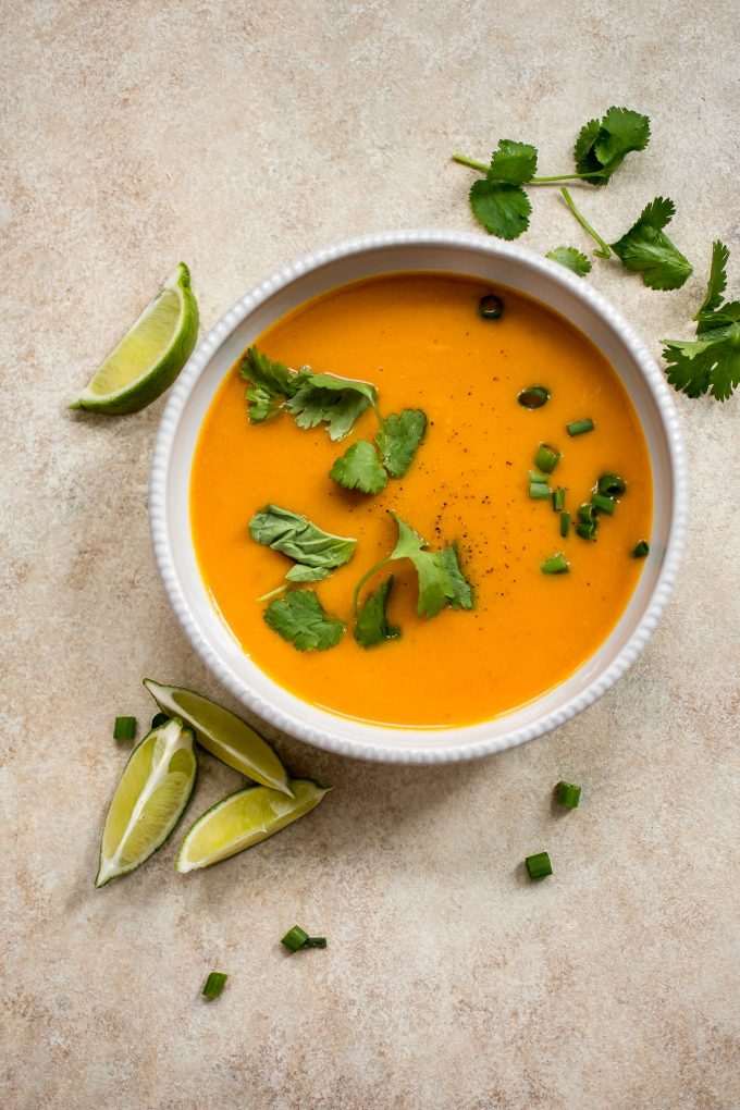 Thai butternut squash coconut curry soup in a white bowl