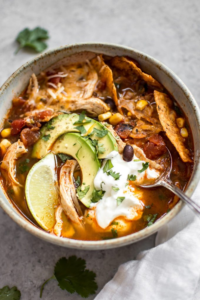 This easy Instant Pot chicken tortilla soup recipe tastes like it's been cooked low and slow, but it's fast and requires minimal effort!