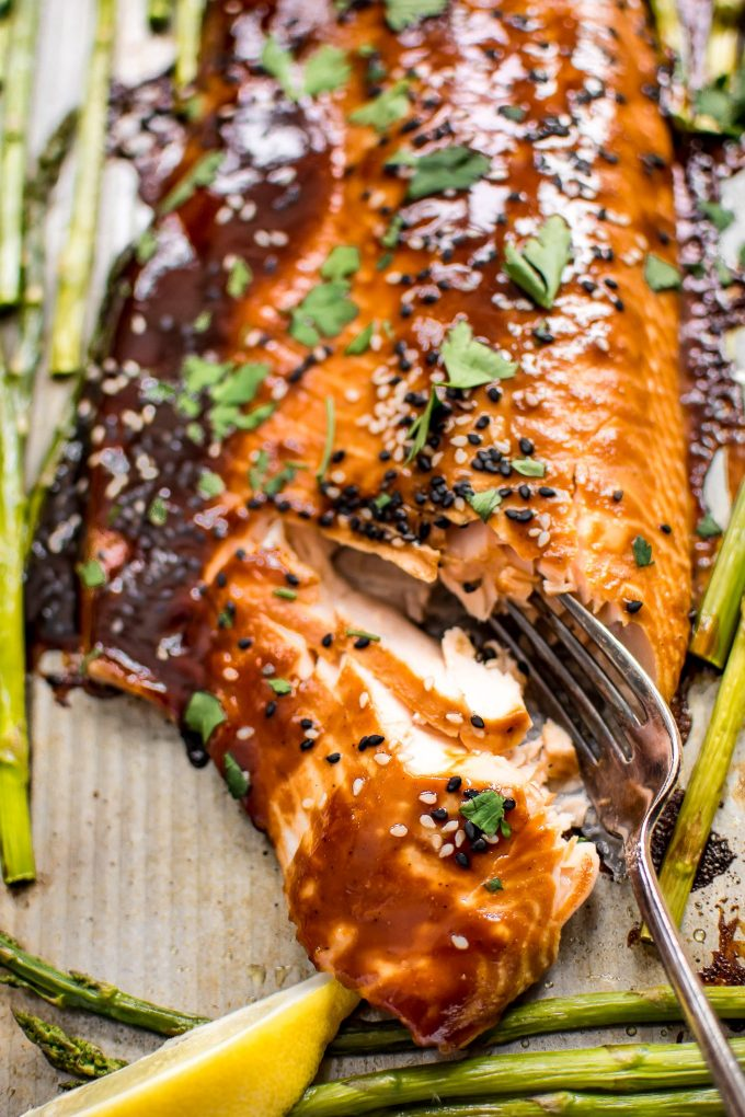 This quick and easy sheet pan salmon and asparagus makes a delicious dinner! The sweet hoisin sauce glaze will have everyone asking for seconds!