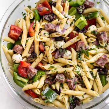 This Italian pasta salad recipe is healthy, fast, and easy to make! It's the best classic cold pasta salad for summer BBQs, picnics, or potlucks. A tangy vinaigrette, salami, mozzarella, and fresh herbs make this one delicious side dish! Feeds a crowd.