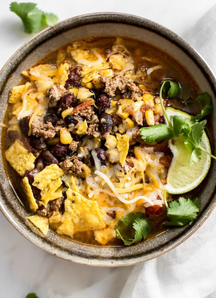 This Instant Pot taco soup recipe is healthy, hearty, and delicious. Add your favorite toppings and it makes a fantastic meal!