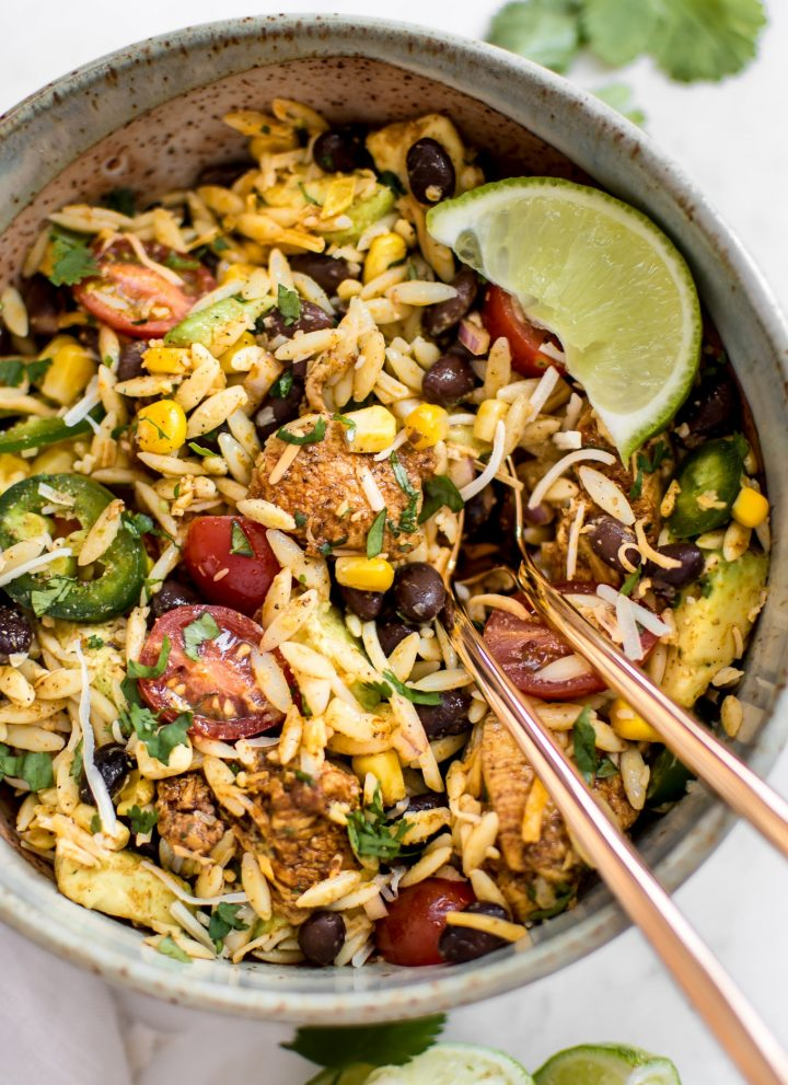 This Mexican chicken salad with orzo is fresh, healthy, and loaded with delicious Tex-Mex flavors including avocado and a delicious cilantro lime dressing! Quick and easy and ready in only 30 minutes - perfect for lunches, weeknight dinners, or potlucks.