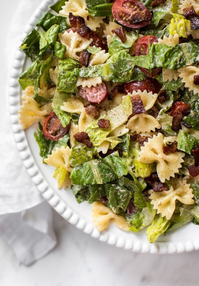 close-up of bacon, lettuce, and tomato pasta salad on a white plate